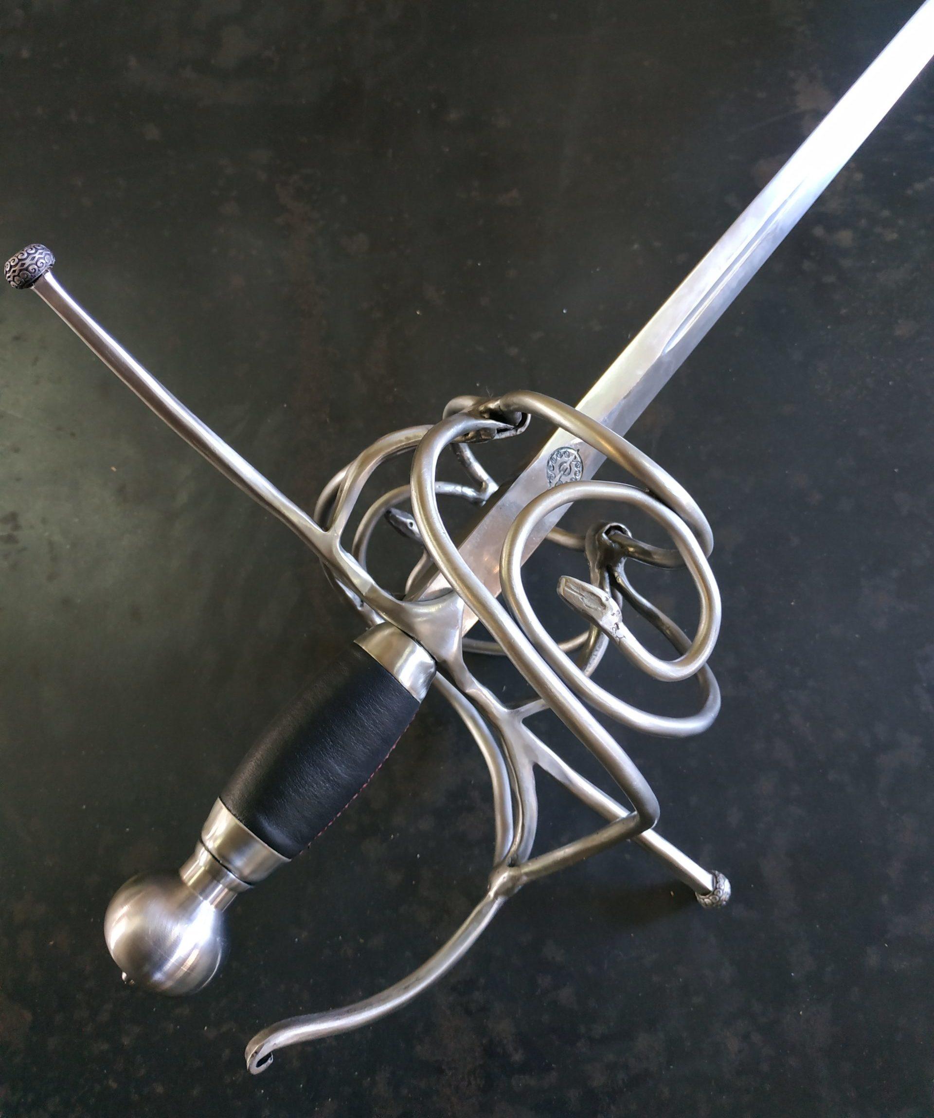 Swepthilt rapier sword with snake decoration. Hilt detail